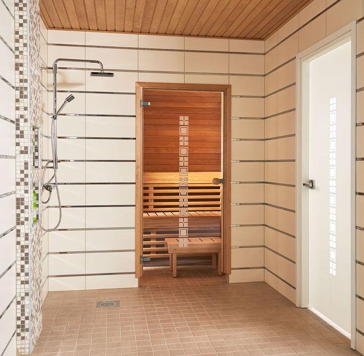 JELD-WENin saunanovi SquareW, leppäkarmi ja pyöreä vedin. Kylpyhuoneenovena Spa-malliston SquareW+.