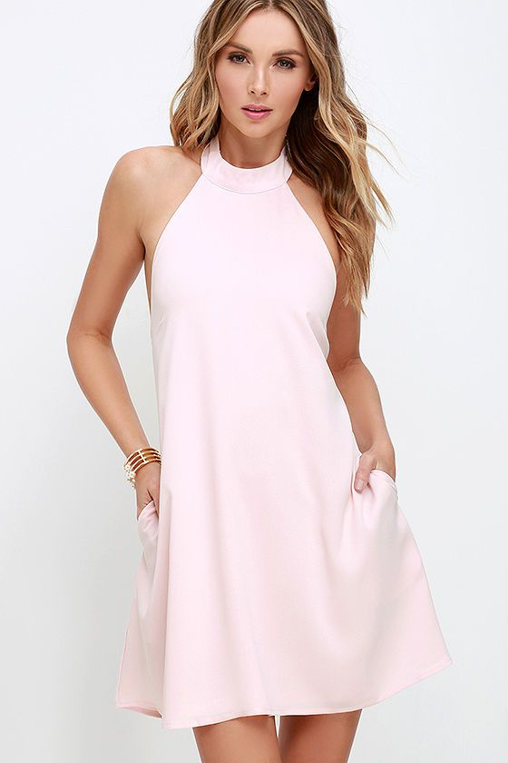 It doesn't take a Superman to sweep us off our feet; the I Need a Hero Light Pink Halter Dress does that on its own! From a tying halter neckline with open back, this dreamy woven poly dress falls to a lovely trapeze silhouette finished with side seam pockets. Hidden back zipper with clasp.