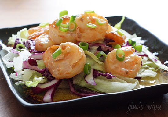 Bangin Good Shrimp Salad - tir fried shrimp mixed with a creamy sweet and spicy chili sauce served on a bed of shredded lettuce and purple cabbage topped with scallions. #weightwatchers