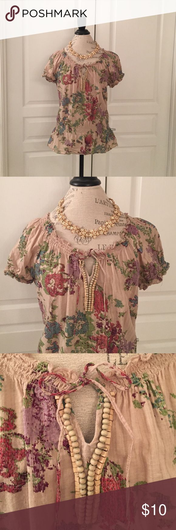 Bohemian Floral Beaded Blouse Peplum style bohemian blouse with front tie and beading. Beading detail make of square and round wooden beads. Gently worn, though still in great shape! Adorable dressed up or down. Size medium. Relativity Tops Blouses