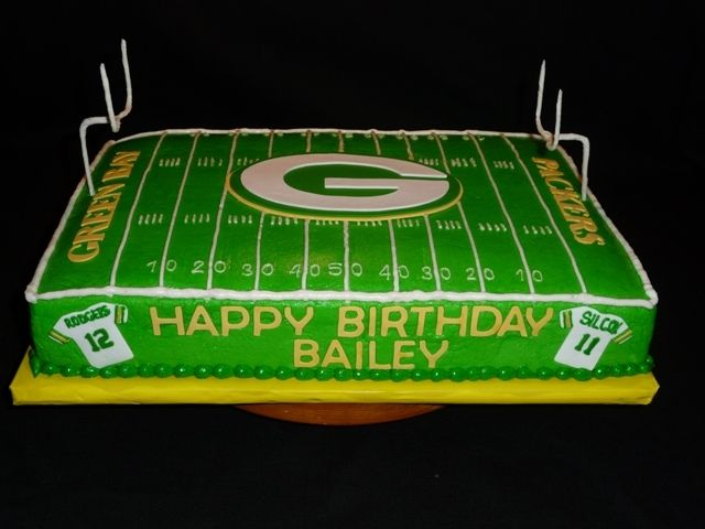 1/4 Sheet cake covered in buttercream with fondant accents.  Field goals are florist wire bent into shape and covered in white florist wire.  I tried to cover them in fondant, but couldnt get it to stick.  The shirts on the sides of the cake are Aaron Rodgers (#12) and then the birthday boys last name and his age (Silcox #11).