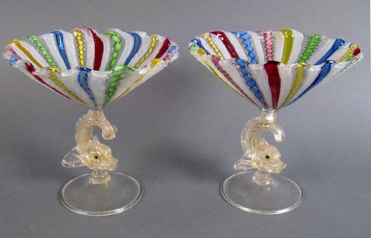 Venetian Glass hand blown Compotes c1910.   A spectacular pair of Venetian glass colored latticiano compotes on figural (dolphin) stems.