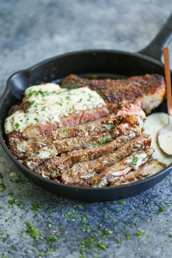 Steak with Garlic Parmesan Cream Sauce - This perfectly tender, juicy steak is served with the most velvety cream sauce that just melts in your mouth!