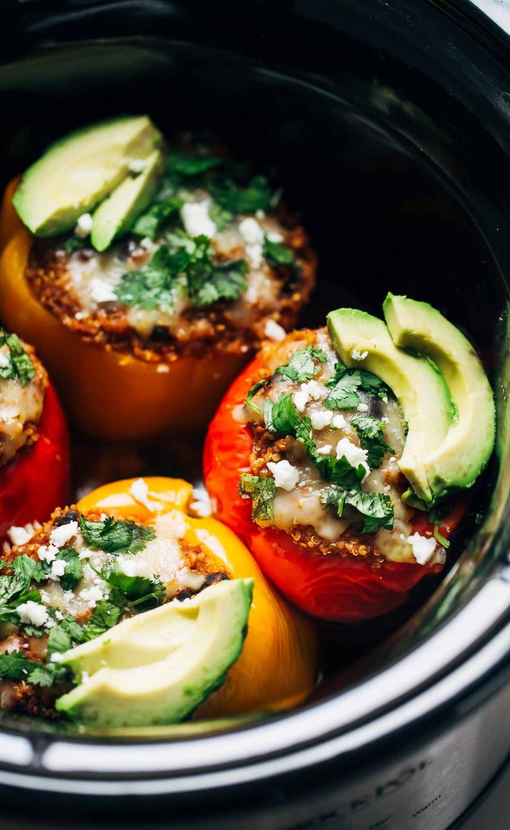 Quinoa Black Bean Crockpot Stuffed Peppers - a super easy vegetarian recipe made with just a few pantry ingredients! Makes awesome leftovers for lunches.