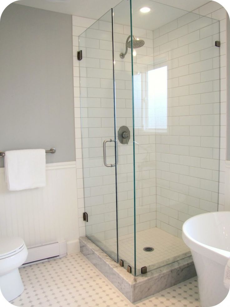 white Shower Room Tile wall connected by glass shower stalls with stainless steel door handle and grey wall theme