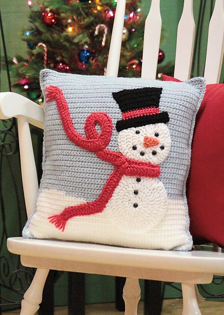 Ravelry: Snuggle With Frosty Pillow pattern by Laura Bozeman. Pattern published in Love of Crochet: Holiday 2012.