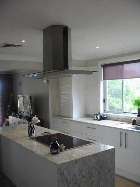 View Through Cooktop And Canopy Hood To Sink Under Window