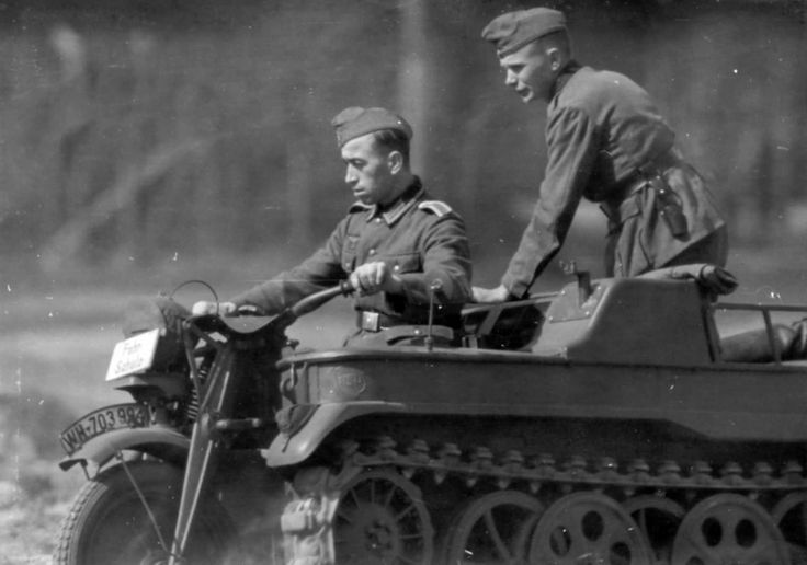 The non-commissioned officer of the Wehrmacht during the practical driving of the multipurpose semi-track tractor NSU NK-101 (Sd.Kfz.2) Kleines Kettenkraftrad with the instructor in the driving school.