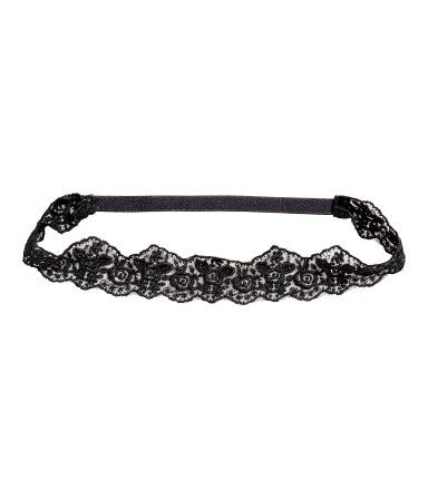 Black. Hairband in lace with elastication at back of neck.