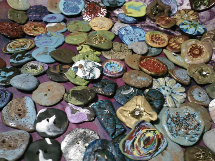 I make my own buttons for the garments that I design. Here is a tray of my hand made buttons