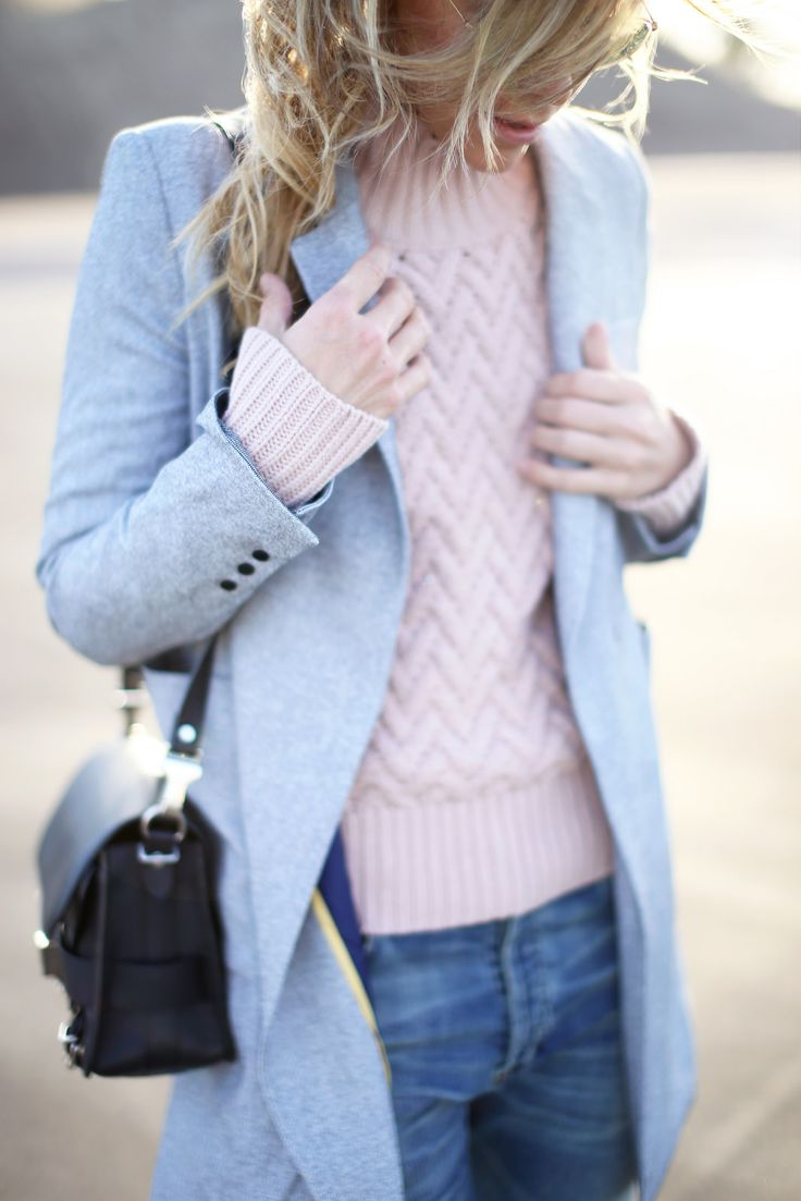 Pastel Outfits: Mary Seng is wearing a pink chevron pattern sweater from Vince Camuto and the pale blue coat is from McGinn: