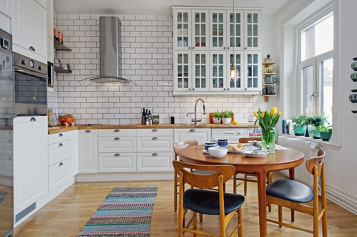 White with butcher block counters and wood floors.