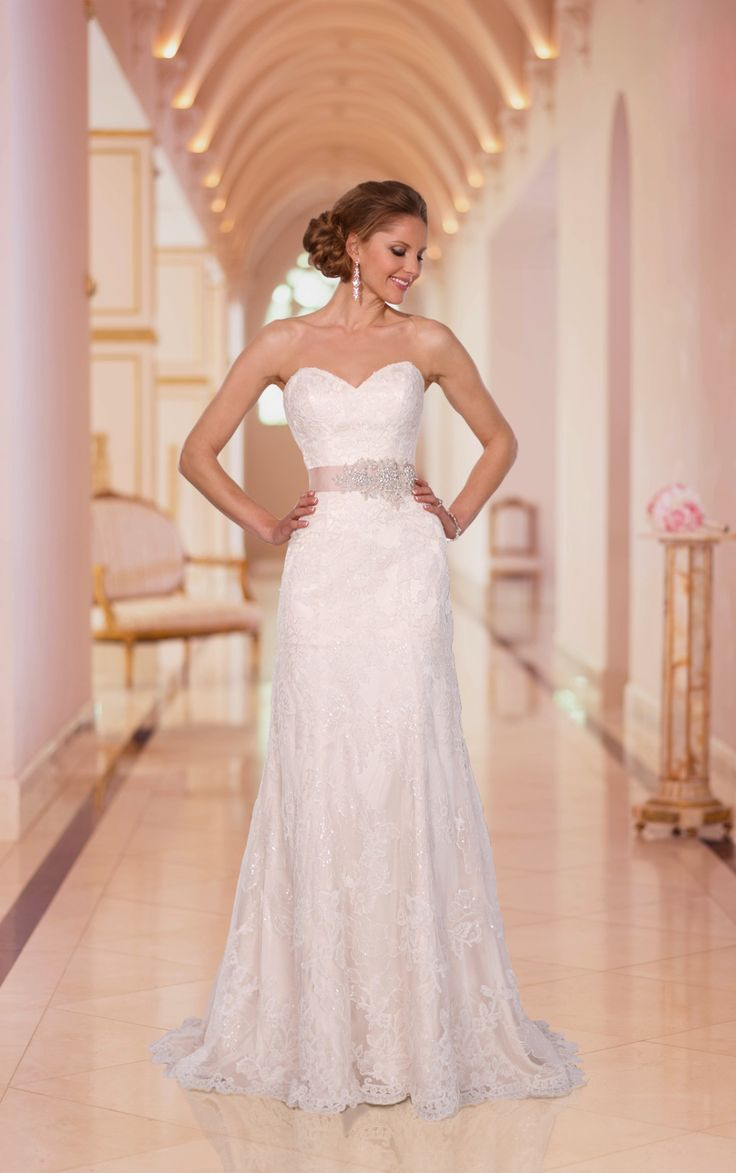Dazzling slim wedding dresses with lace showcase an A line frame and Diamante beading. Exclusive designer slim wedding dresses by Stella York.