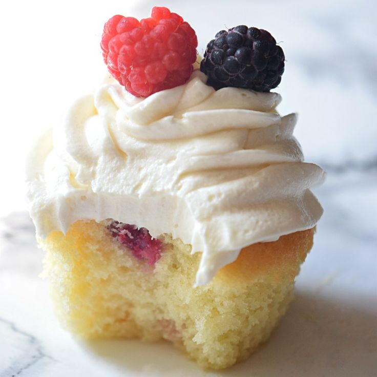 Berry Cupcakes filled with berry marmalade and topped with the freshest berries EVER! | Click Now for the full recipe and instructions!! | carmelapop.com