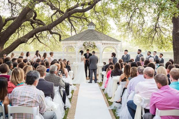 Outdoor wedding venue in Dallas/Jupiter Gardens Event Center has a charming white gazebo shaded by two mature oak trees