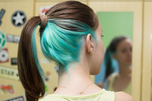 I looks great on wavy brown hair if you draw a few turquoise strands forward over your shoulders.