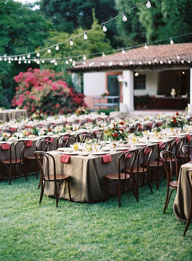love the string lights at this outdoor wedding reception