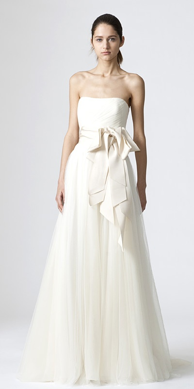 """Vera Wang's """"Delaney"""", a strapless soft A-line gown with woven criss cross bodice and gathered skirt"""