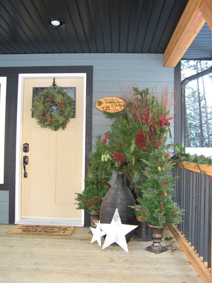 Evergreen Christmas trees and wreaths greet our guests