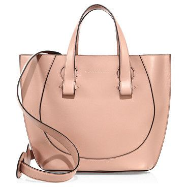 """Tulip small leather tote by Victoria Beckham. Smooth leather tote with gently curved tulip shapeDouble top handles, 4.75"""" dropRemovable, adjustable shoulder strapG..."""