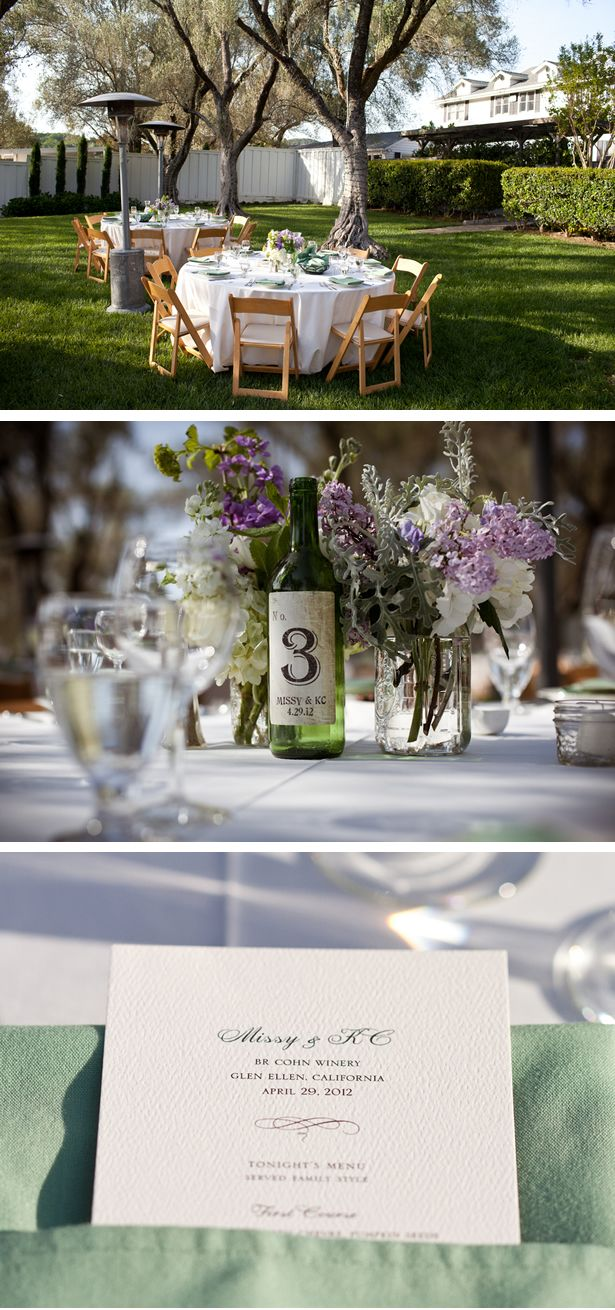Empty wine bottles mark table numbers. Love.