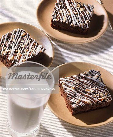 http://image1.masterfile.com/getImage/659-06373735em-Walnut-Brownies-with-Icing-on-Plates--Glass-of-Milk.jpg