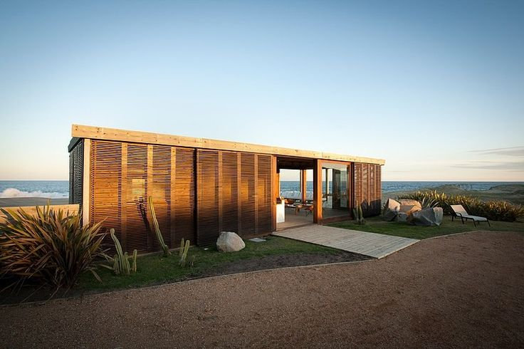 idea for hurricane shutters/security as part of architectural design - Beach House by Martin Gomez Arquitectos