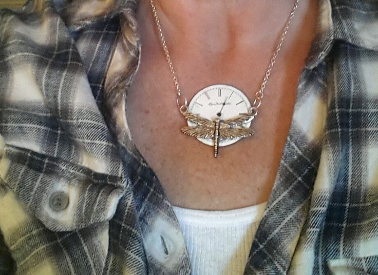 Interesting idea: necklace made from an old pocket watch and a broken brooch...