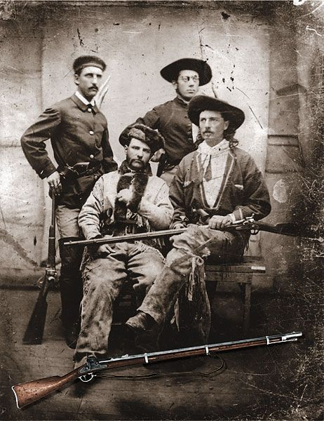 For most of his buffalo hunting, Cody used a rifle like the one shown in the inset. He affectionately called this early trapdoor single-shot arm Lucretia Borgia, which he holds in his lap above. Although broken in half, the original rifle rests at the Buf