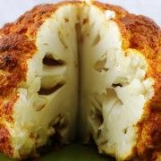 "Spicy Whole Roasted Cauliflower | Recipes - PureWow--points for creativitiy? This cauliflower is basted in a spiced Greek yogurt ""marinade"" and then roasted to form a crust. I have to try this."