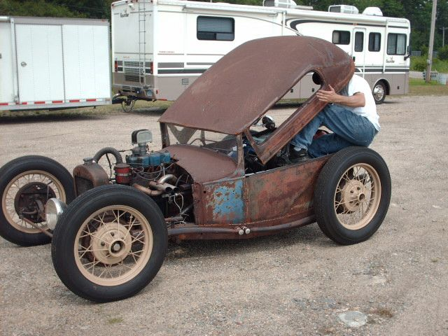 Flip-top rat rod. Looks like a 4-cylinder. One headlight. Fun to see someone thinking outside of the box!  http://www.killbillet.com/showthread.php?t=10376