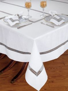 Atelier Table - Fine #Table #Linens - A great conversation piece for your guests, unique inserts of Grey lace with the look of macramé are beautifully presented on crisp White Italian linen. Made in Italy for your entertaining pleasure, these fascinating tablecloths, placemats and generously sized napkins will bring a unique look to your table. #luxury