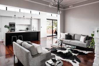 The living space is large and open, with a flow through to the kitchen and dining area