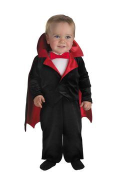 Full body velvet jumpsuit with attached red satin lined cape, and snap closure pants. 100 percent polyester. TODDLER size 12-18M.