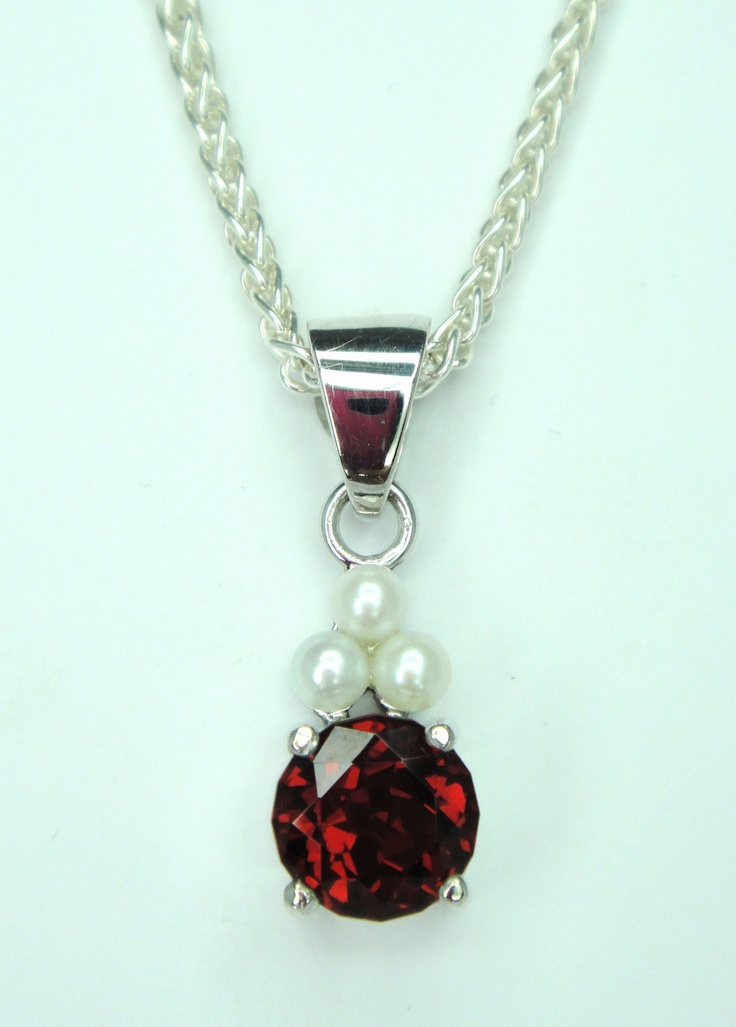 Pearls and a beautiful Garnet set in White Gold