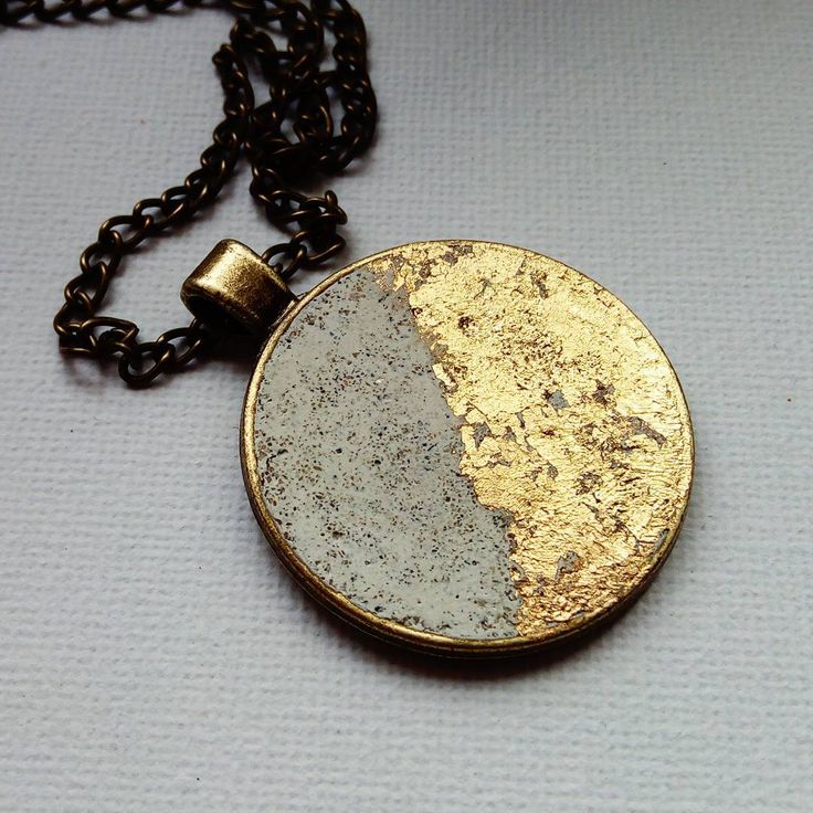 Minimal concrete necklace with gold metal flakes.