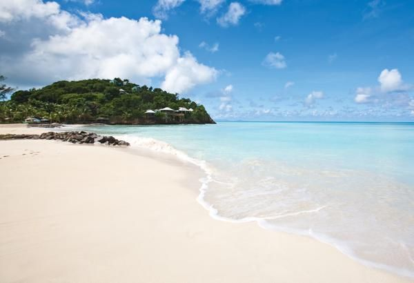 jolly beach resort, antigua, west indies. Also all-inclusive and not too expensive. The beach looks gorgeous!