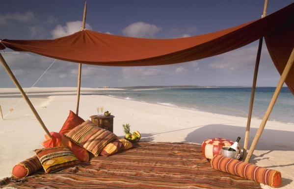 Mozambique's island lodges create opportunities for romance - dine Bedouin-style at Benguerra Lodge, within the Bazaruto Archipelago, a chain of tropical islands, off of southern Mozambique.