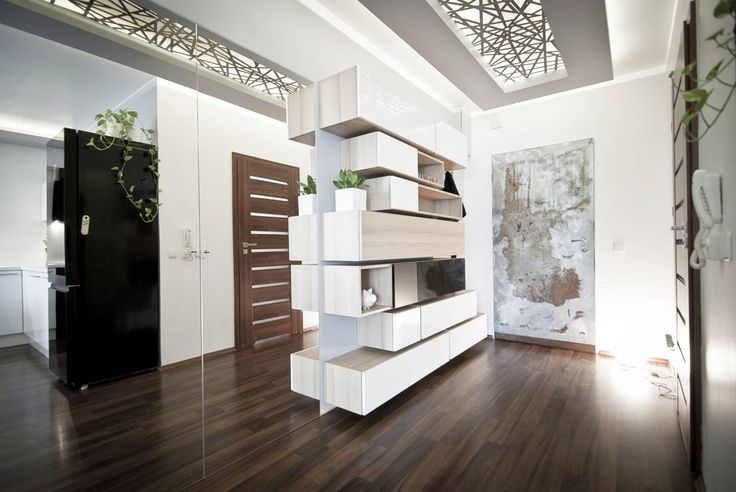 Apartament Cegielniana Kraków : Minimalistyczny korytarz, przedpokój i schody od Novi art
