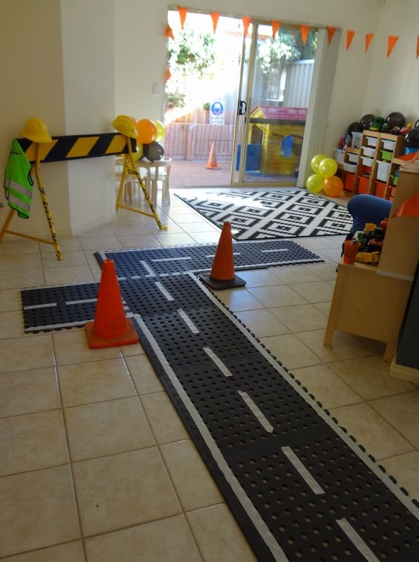 I used black foam squares (Bunnings Warehouse) to create a road with white masking table to create the markings. The kids loved pushing diggers, cars and trucks down the 'road'.