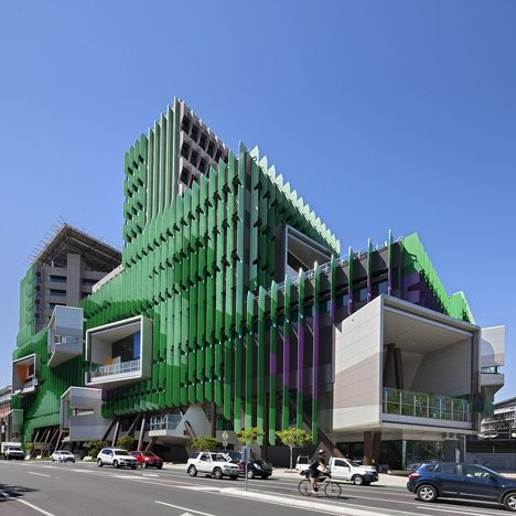Huge green and purple fins shade the glass facades of this children's hospital in Brisbane