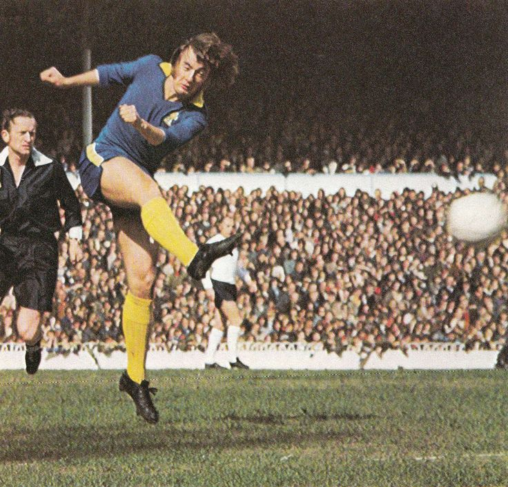 15th April 1972. Chelsea midfield genius Alan Hudson shooting against Tottenham Hotspur.