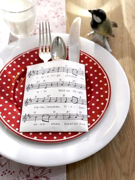 Music sheets use to dressed utensils instead of table napkins.