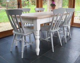 This traditional farmhouse table is hand painted with a subtle distressed finish…