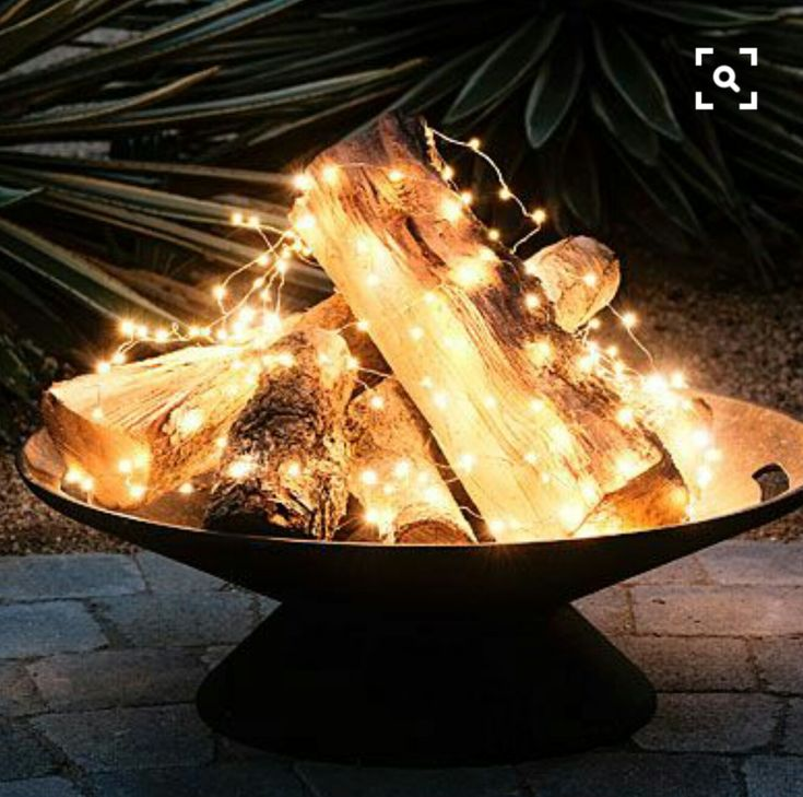 Great idea for a summer fire pit (or when/wherever real fire wouldn't be fun): mini wire strand LEDs