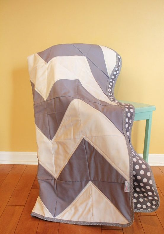 Chevron quilt made with large triangles -- perfectly simple, great way to bring slight pattern without going overboard! #sewing #quilting