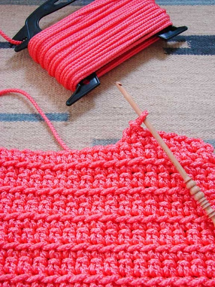 Crochet a rug using nylon rope from the hardware store - 5 packages of hot pink poly rope (50 lb.- 75 feet each spool). What's a girl to do with 375 feet of hot pink rope? Make a rug! I used a simple crochet stitch and a size 6 hook (I'd recommend using bigger).