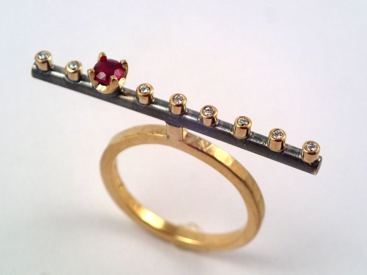 The flute. A 18K solid gold band statement ring with a genuine ruby and eight diamonds. by TomisCraft on Etsy