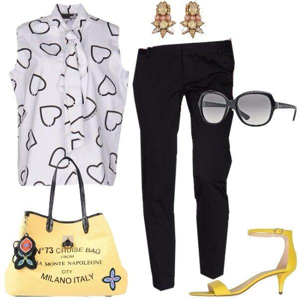 Pantaloni neri e camicia con sfondo bianco, grandi cuori e fiocco sono alla base di un outfit veloce che si completa con sandali colorati e comodi con cinturino alla caviglia, borsa divertente, occhiali neri e orecchini dalla foggia particolare.