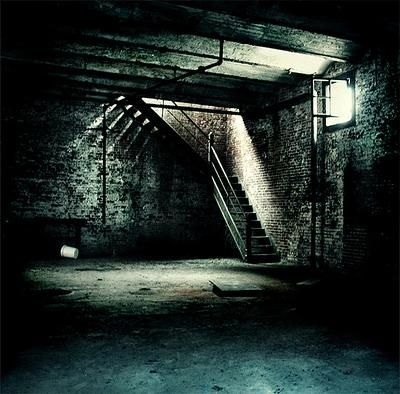 This is what it looks like (the stairs are in the middle of it and it's darker in my dreams). Also, this looks nothing like the basement in real life at my house. I've had more than one dream about the basement in my family's house.   There is always an awful feeling down there (in my dreams). There are murderers